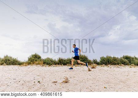Male Runner Run An Evening Training On Sandy Beach