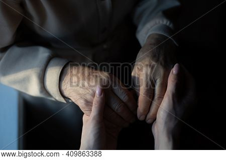 Very Elderly Great-grandmother And Granddaughter Hold Hands