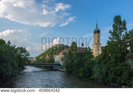 Mur River, The Franciscan Church Tower And The Famous Clock Tower (grazer Uhrturm) In The Background