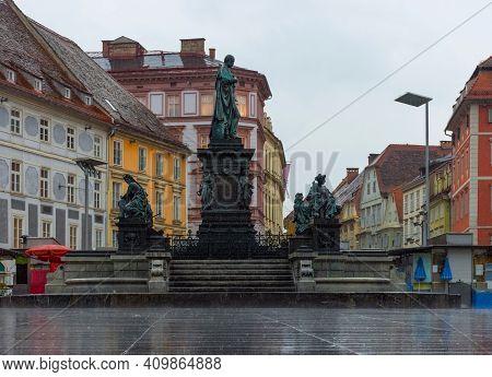 Erzherzog Johann Fountain At Hauptplatz (main Square) In A Rainy Day, In Graz, Styria Region, Austri