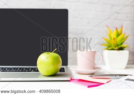 Healthy Snack With Working In Office.  Close Up Green Apple With Back Coffee Pink Cup For Diet Healt