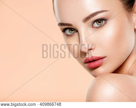 Beautiful face of young woman with health fresh skin. Portrait of beautiful  brunette woman with clean face. Closeup face of young adult woman with clean fresh skin. Skin care.