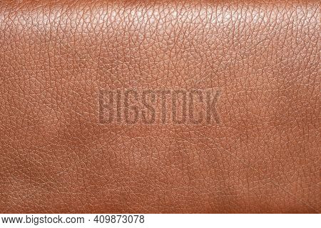 The Background Of The Leather Upholstery Of The Chair Is Close-up. Leather Upholstery Texture