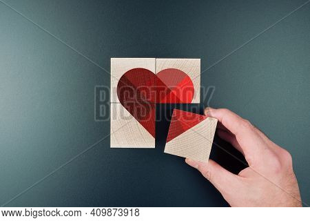 Above View Of Person Piecing Together Heart Shape On Wooden Blocks, Love And Romance Concept