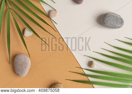 Zen Flat Lay Composition With Green Leafs And Stones. Tropical Leaf And Sea Pebble On Beige Backgrou