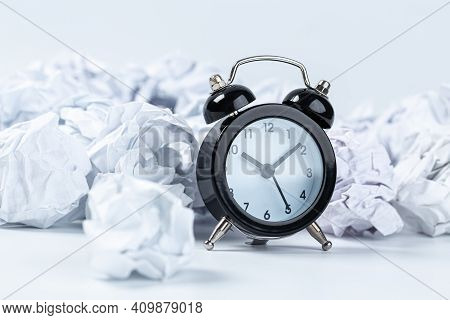 Alarm Clock With Crumpled Paper Balls.timing And Thinking Idea Concept.