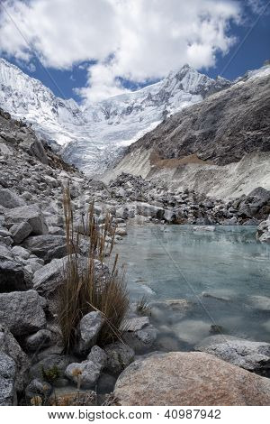 Glacier and moraine with river, Llaca valley, Cordilleras Blanca, Peru