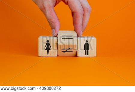 Symbol For Gender Equality. Hand Turns A Cube And Changes A Unequal Sign To A Equal Sign Between Sym