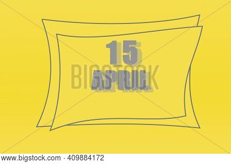 Calendar Date In A Frame On A Refreshing Yellow Background In Absolutely Gray Color. April 15 Is The