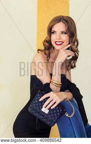 Happy Glamorous Celebrity Young Woman With Handbag