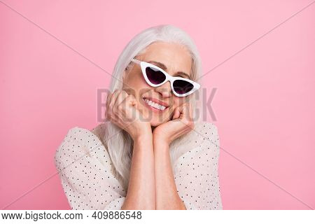 Close-up Portrait Of Attractive Cheerful Grey-haired Woman Wearing Specs Enjoying Isolated Over Pink