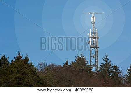 Mobile network radio mast in front of blue sky poster
