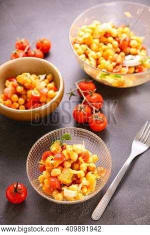 chickpea salad with tomato and spicy