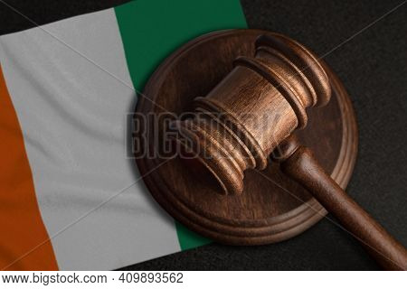Judge Gavel And Flag Of Cote D'ivoire. Law And Justice In Cote D'ivoire. Violation Of Rights And Fre