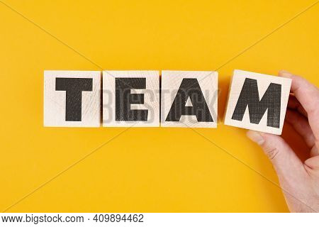 Above View Of Word Team On Wooden Blocks Against Orange Background