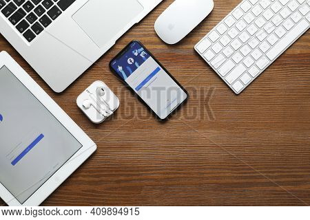 Mykolaiv, Ukraine - August 28, 2020: Flat Lay Composition With Modern Apple Company Gadgets On Woode