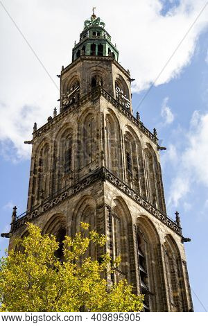 Groningen, The Netherlands - 17 Oct, 2020: The Martini Tower With A Tree In The Front Against The Sk