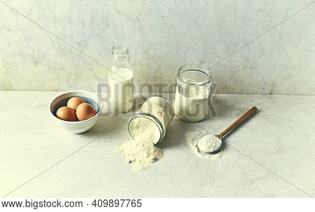 Wheat flour, coconut flour, eggs and milk for cake making. Homemade food concept