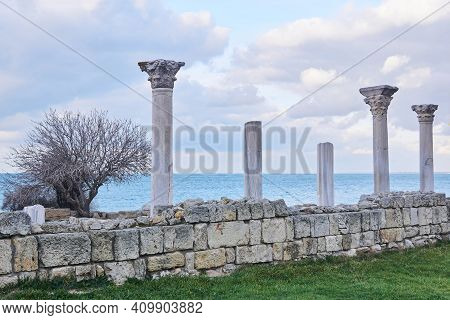 Ruins Of An Ancient Greek Temple With Columns By The Sea Shore
