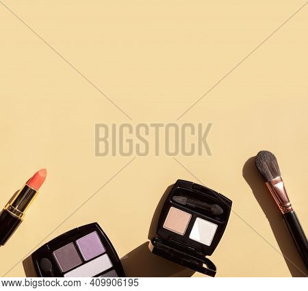 Decorative Cosmetics For Make-up With Sun Shadows On Beige Background Flat Lay Top View. Eyeshadow P