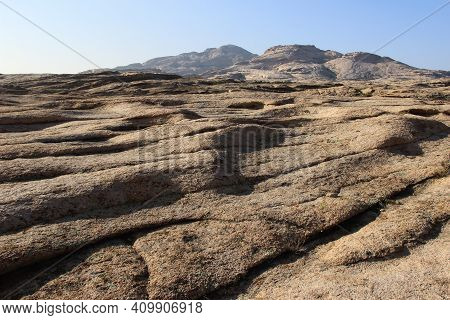 Volcanic Undulating Stone Mountains In The Bektau-ata Tract, In Front Of A Close Low Mountain Slope,