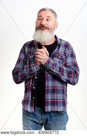 Mature Bearded Man Join Hands Together Begging For Forgiveness In Trouble, Asking For Help, Isolated