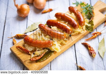 Grilled german sausage links served with sauerkraut or sour cabbage