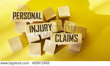 Text Personal Injury Claims Written On A Wooden Block , Concept.