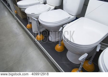 Sale Of Toilet Bowls.a Store That Sells Plumbing Fixtures.