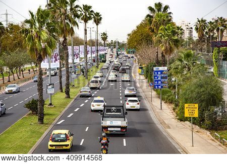 Israel, Tel Aviv, March, 20, 2016 - Top View Of Multi-lane Freeway With City Traffic In The Streets