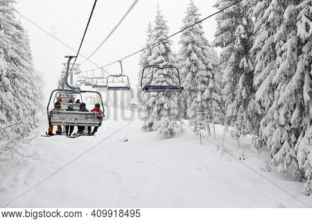 Bukovel, Ukraine - December 25:  The Skiers Are On A Cableway In Bukovel Ski Resort. It Is The Large