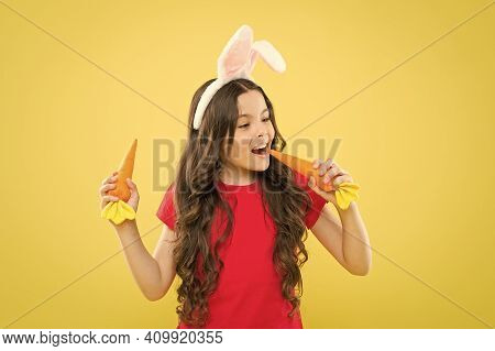In Love With Healthy Food. Child In Bunny Ears. Nutrition Diet For Health. Benefit Of Eateing Carrot