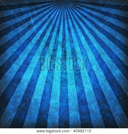 Blue grunge sunbeams background or texture