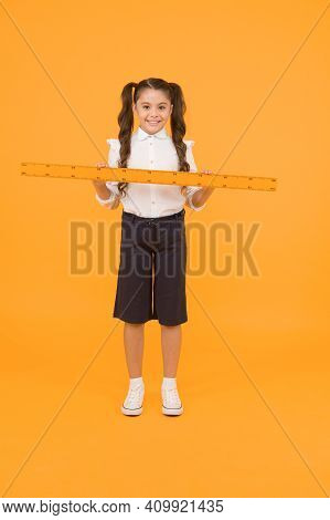 Tell Me About Distance. Kid School Uniform Hold Ruler. Pupil Cute Girl With Big Ruler. Geometry Scho