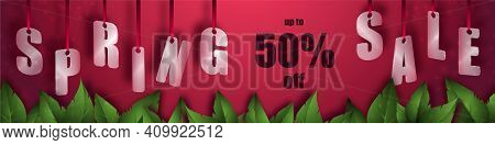 Spring Sale Background With Beautiful Leaves. Translucent Glass Or Plastic Letters On Red Silk Ribbo