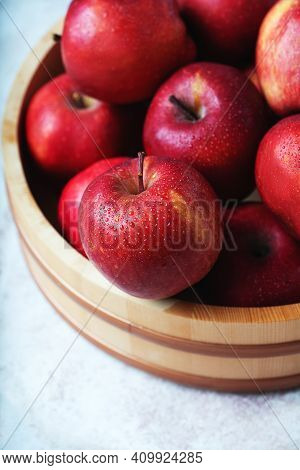 Ripe Apples Starking In The Wooden Bowl