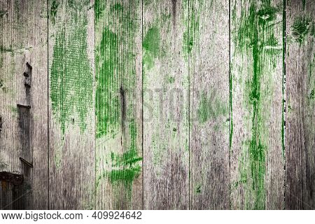 Green and grey wooden grunge board closeup. Natural texture. Can be used like nature background
