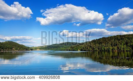 A beautiful lake with reflection and blue sky