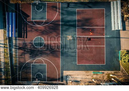 Public Basketball Court Aerial Top View. Above Empty Outdoor Sport Court View From Drone.