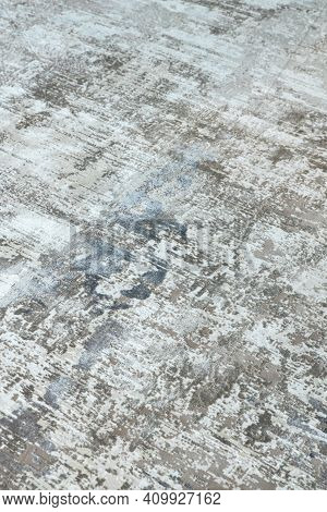 Background From A Stylish Carpet In Neutral Gray-beige-blue Tones With Fading And Artificial Antiqui
