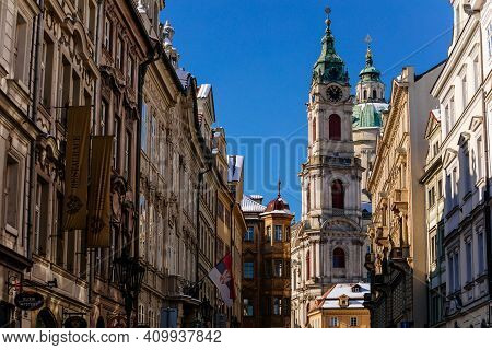 Mostecka Street With A View Of Baroque Church Of Saint Nicholas, Old Town With Historical Buildings,