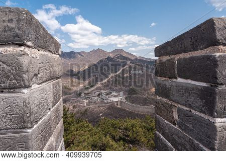 Beijing, China - April 28, 2010: Great Wall Of China. Looking Through Battlements Upon Meandering Wa