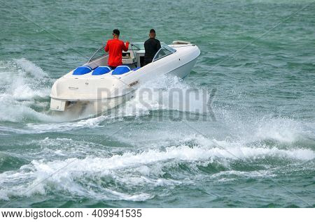 Angled Elevated View Of A Small High-end Sporty Runabout Motorboat.