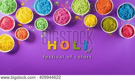 Happy Holi Festival Decoration.top View Of Colorful Holi Powder On Purple  Background With The Text