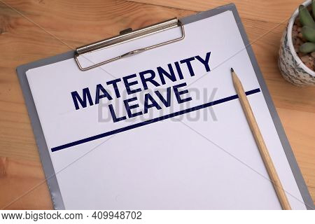 Maternity Leave, Text Words Typography Written On Book Against Wooden Background, Life And Business