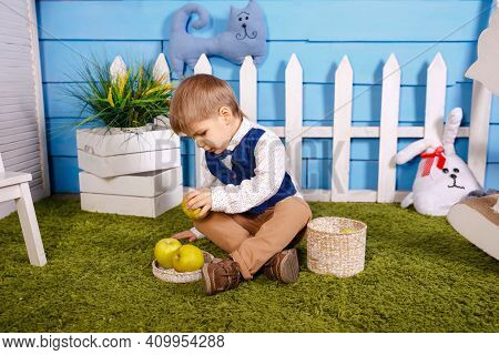 Kid Is Gathering Autumn Fall Harvest. Portrait Of Adorable Funny Boy. Picnic In Nature. Cute Funny L