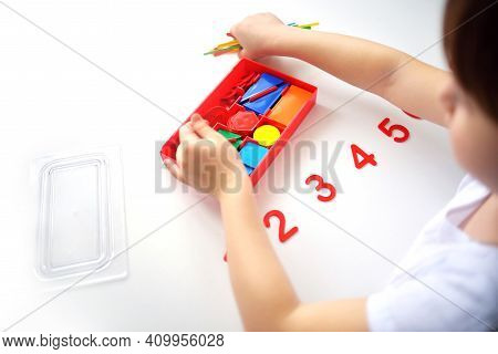The Child Learns Number Line And Geometric Shapes. The Preschooler Works With Montessori Material. E