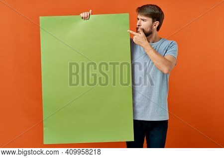 Emotional Man Holding Mocap Poster Advertising Communication In Hand