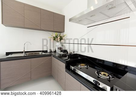 Kitchen With Built In Appliance, Electric Cooker Hood, Stove, Oven And Sink. Home Kitchen.