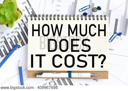 How Much Does It Cost. Business Concept. Text On White Notepad Paper On Light Background
